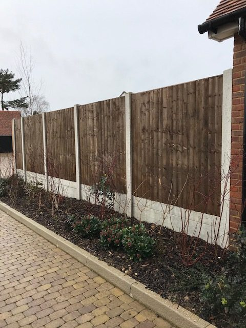 Retaining Fence with Concrete Posts and Gravel Boards