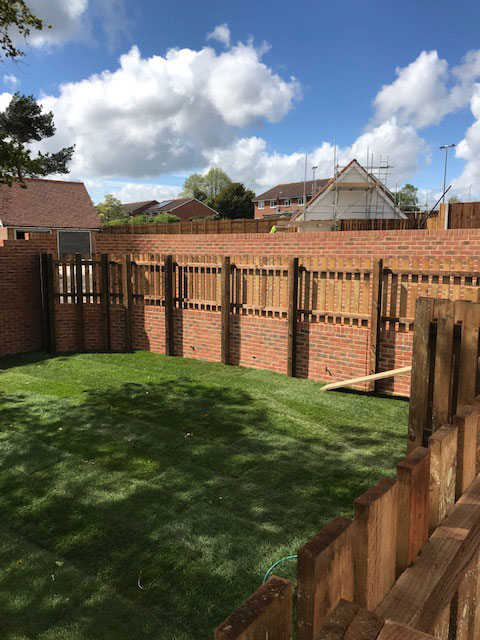 Picket Fence on a retaining wall